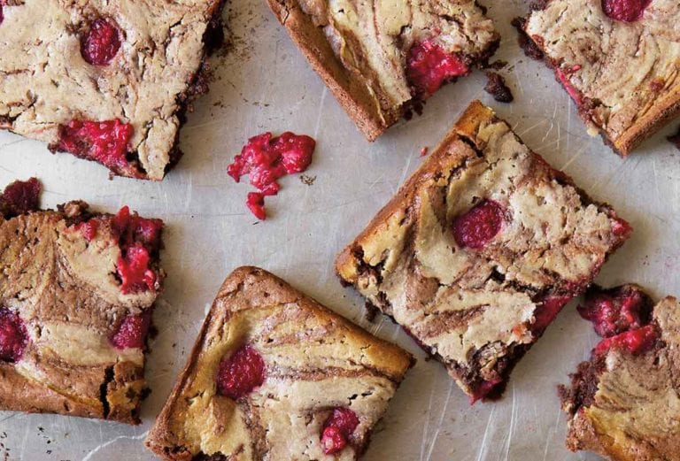 Squares of raspberry cheesecake brownies.