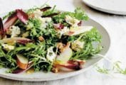 Plate of an endive, blue cheese, and pear salad with walnuts
