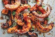 A pile of grilled half-moon slices of butternut squash