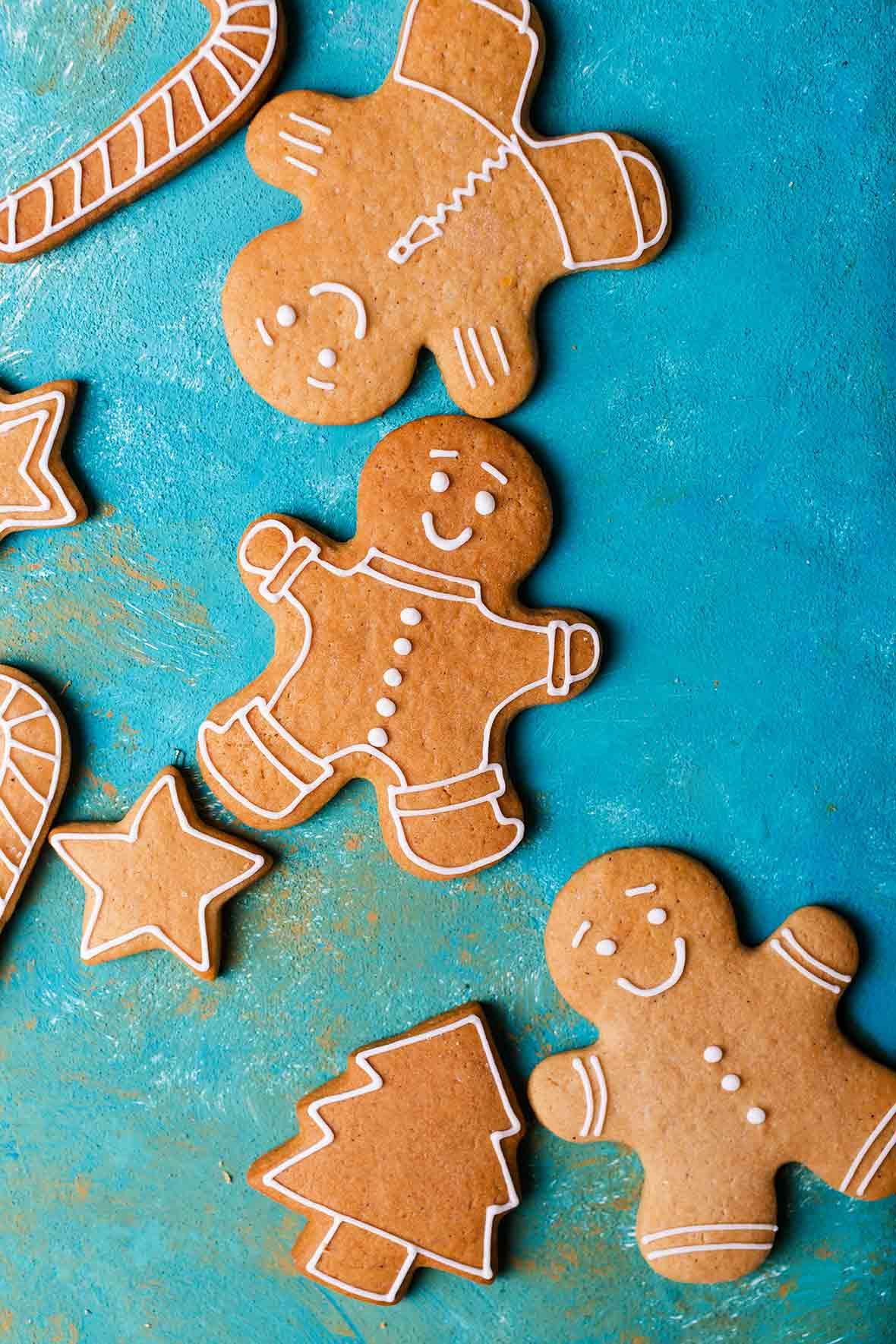 A selection of decorated gingerbread cookies in the shapes of men, stars, and trees