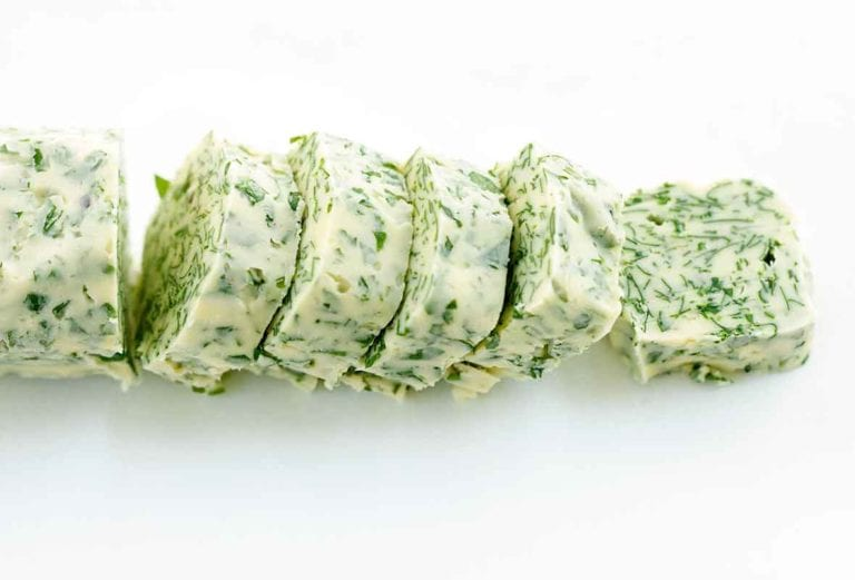 a roll of butter flecked with minced parsley