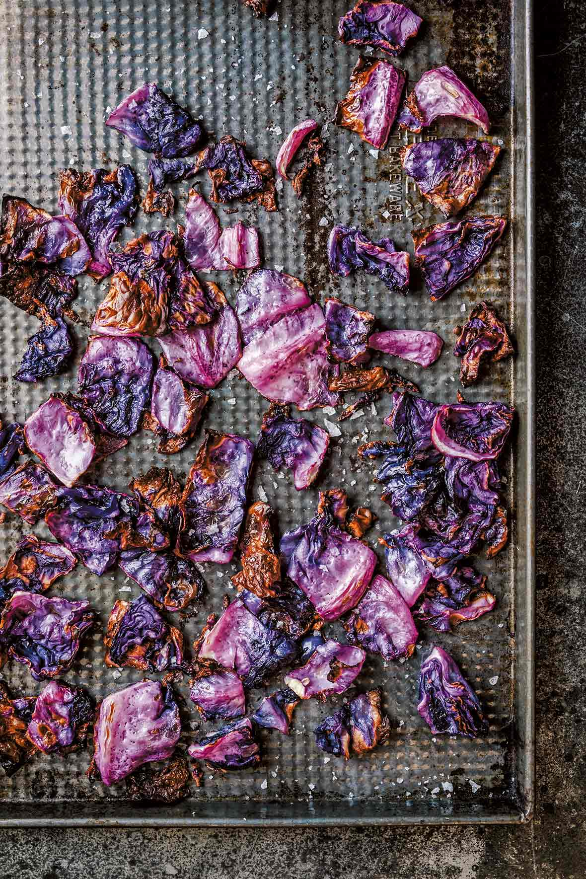 Roasted red cabbage on a cooling rack set in a baking sheet
