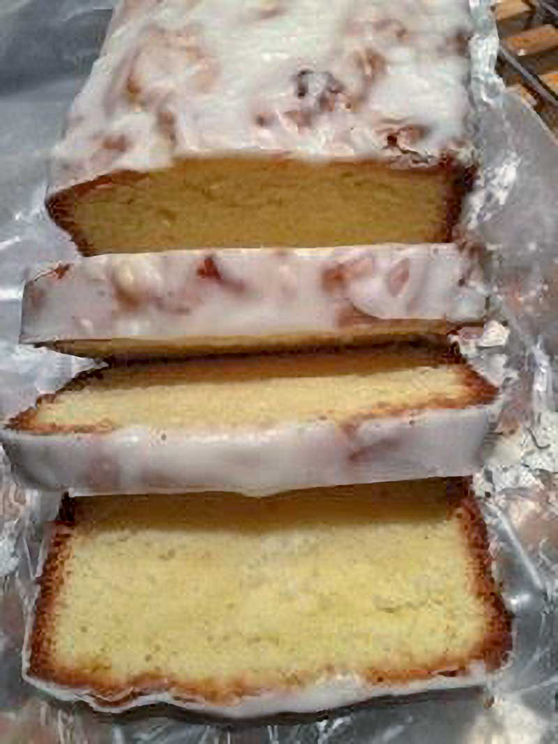 A vanilla pound cake with a lemon glaze cut into 8 slices