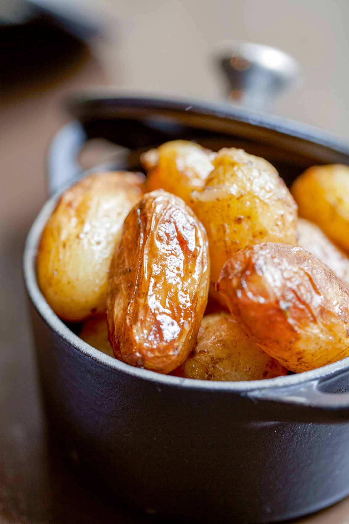Cast iron pot with braised new potatoes inside