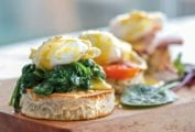 Eggs Florentine--a round of butter toast topped with creamed spinach, poached egg, and Hollandaise sauce