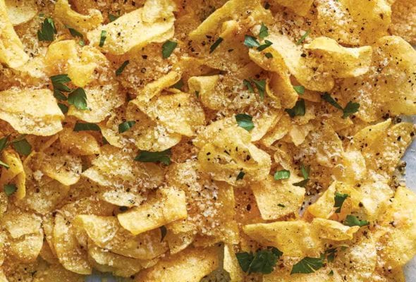 Cacio e pepe potato chips--chips topped with cheese, black pepper, and parsley