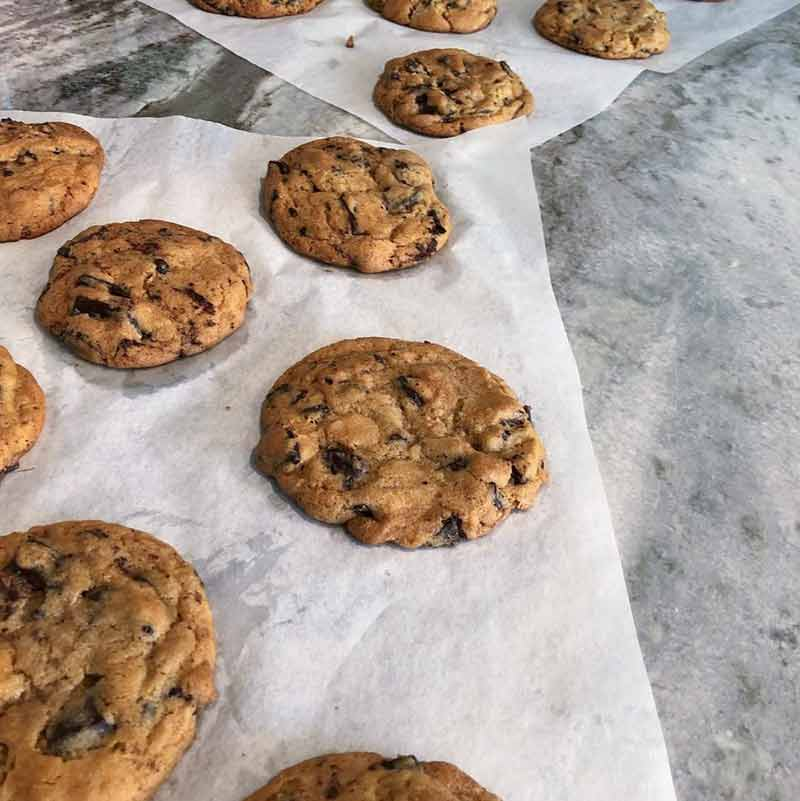 Parchment sheets with a dozen of David Leite's chocolate chip cookies that were featured in the NY Times