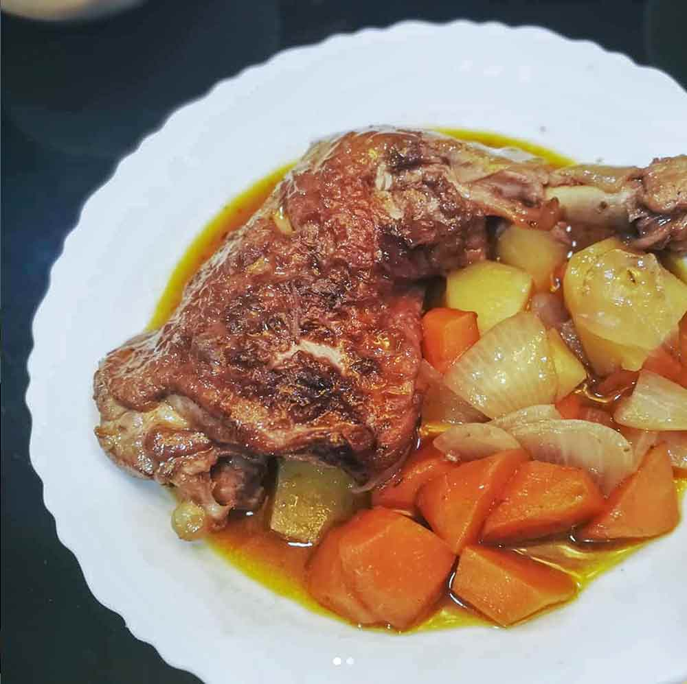 5449bc08a49c61 White plate with coq au vin--white sear chicken legs in a wine sauce