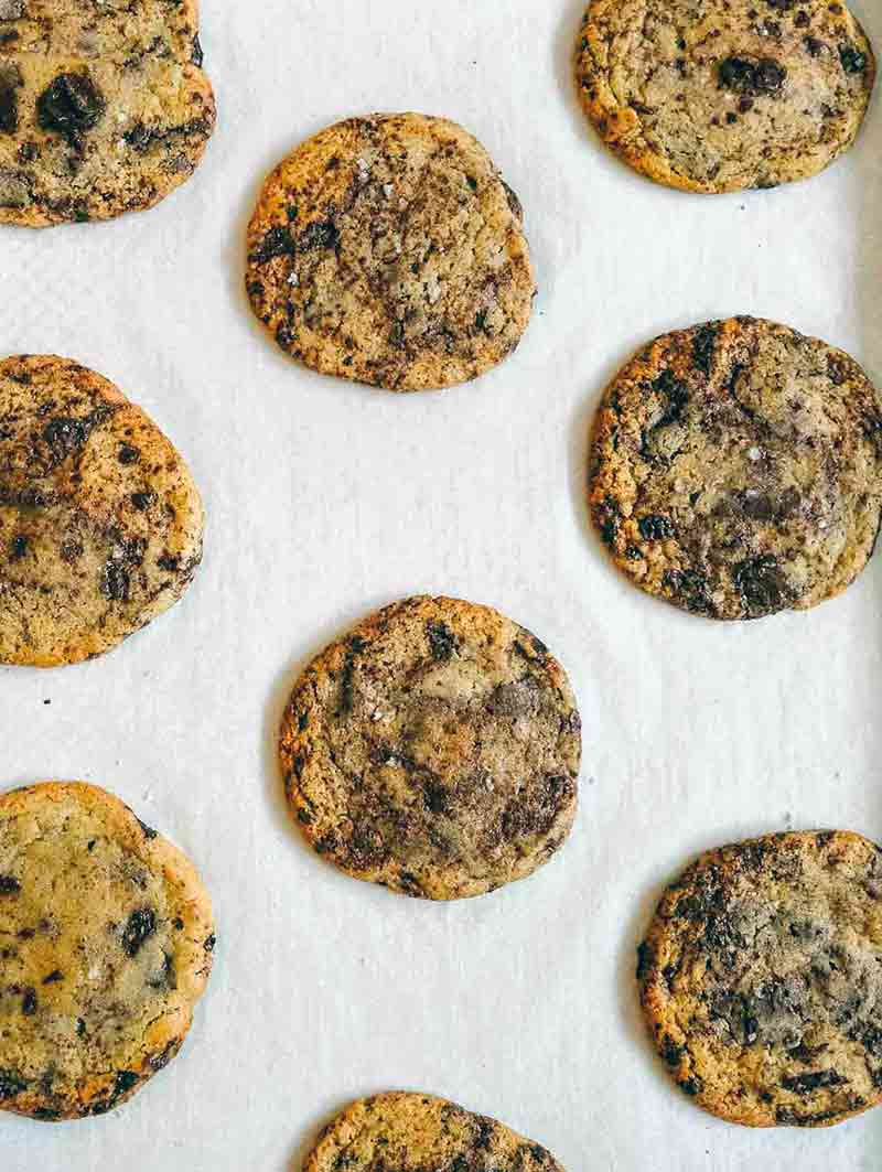Parchment-lined baking sheet with 9 thousand layer chocolate chip cookies