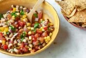 A yellow bowl of cowboy caviar--black-eyed peas, corn, red onion, tomato, red and yellow pepper by Dorie Greenspan