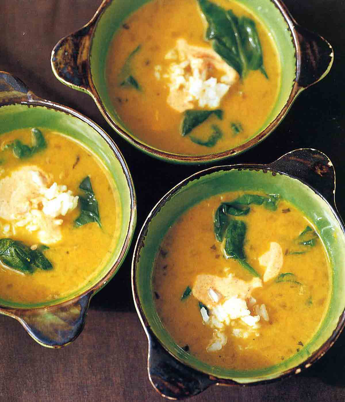 This hearty, healthy yellow pea and coconut milk soup is filled with plenty of goodness, including rice, spinach, and spices.