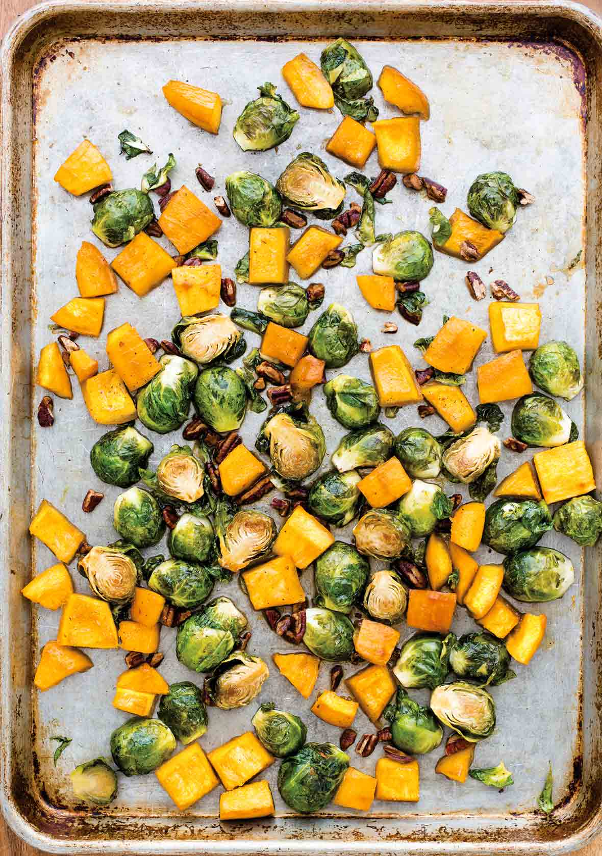Sheet pan with chunks of roasted pumpkin and Brussels sprouts