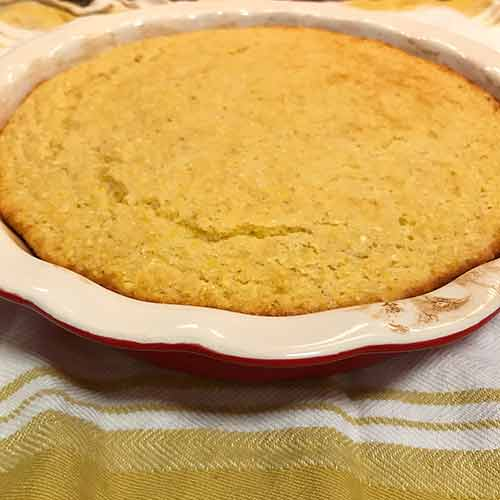 Pie pan with warm cornbread inside