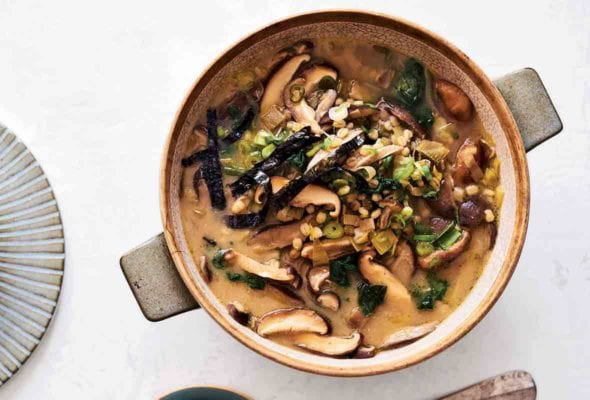 A crock filled with shiitake barley soup--mushroom, leeks, miso, ginger, scallions, nori seaweed
