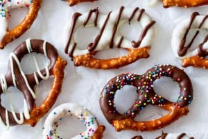 An assortment of chocolate covered pretzels with white and dark chocolate coating and sprinkles