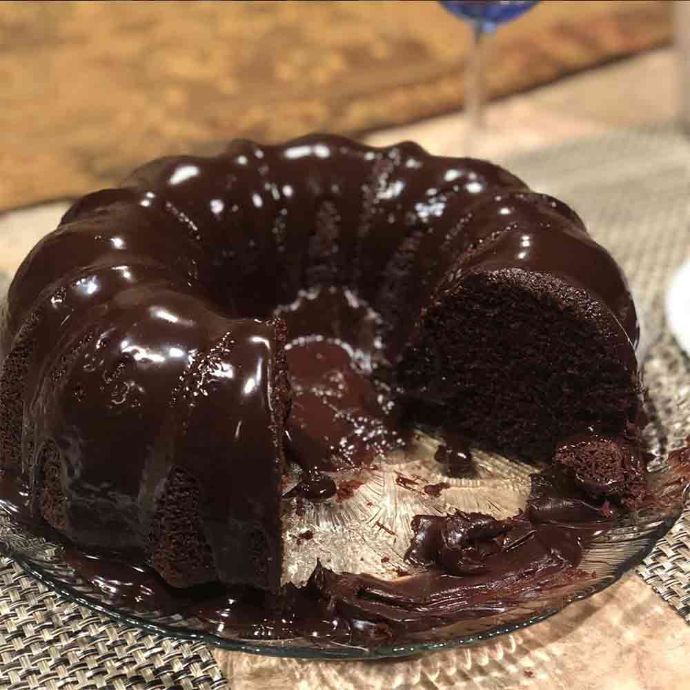 A chocolate sour cream Bundt cake topped with a rich, thick chocolate ganache
