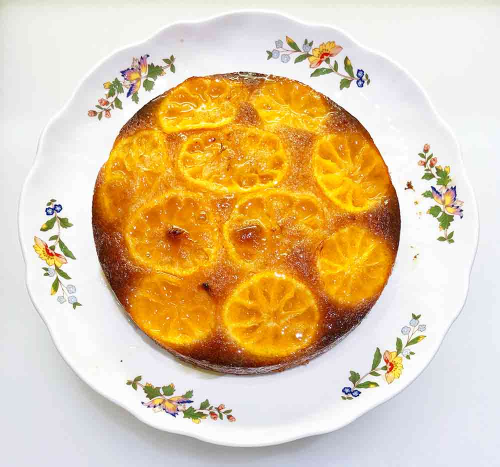 An upside-down clementine cake, with golden slices of clementines showing