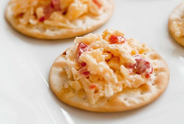Crackers topped with pimento cheese.