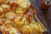 A glass casserole dish filled with golden brown easy scalloped potatoes