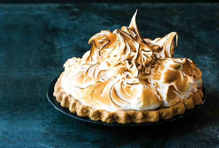 A lemon meringue pie topped with clouds of toasted meringue