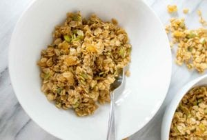 Two white bowls filled with soft ginger granola