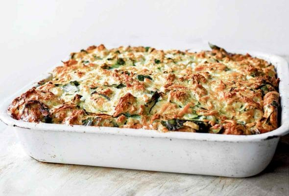 A white baking dish filled with zucchini strata