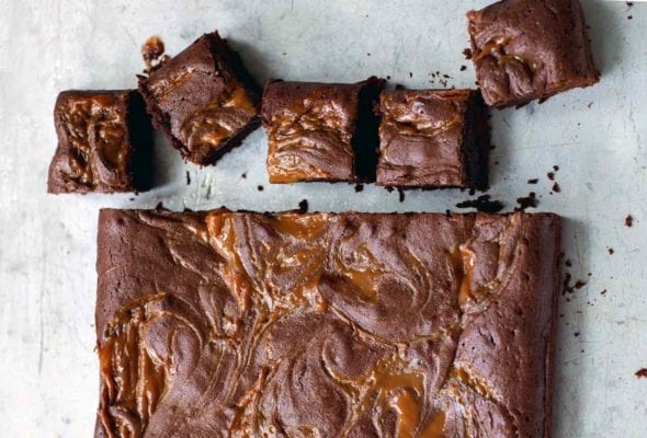 A slab of dulce de leche brownies with 5 brownies cut off