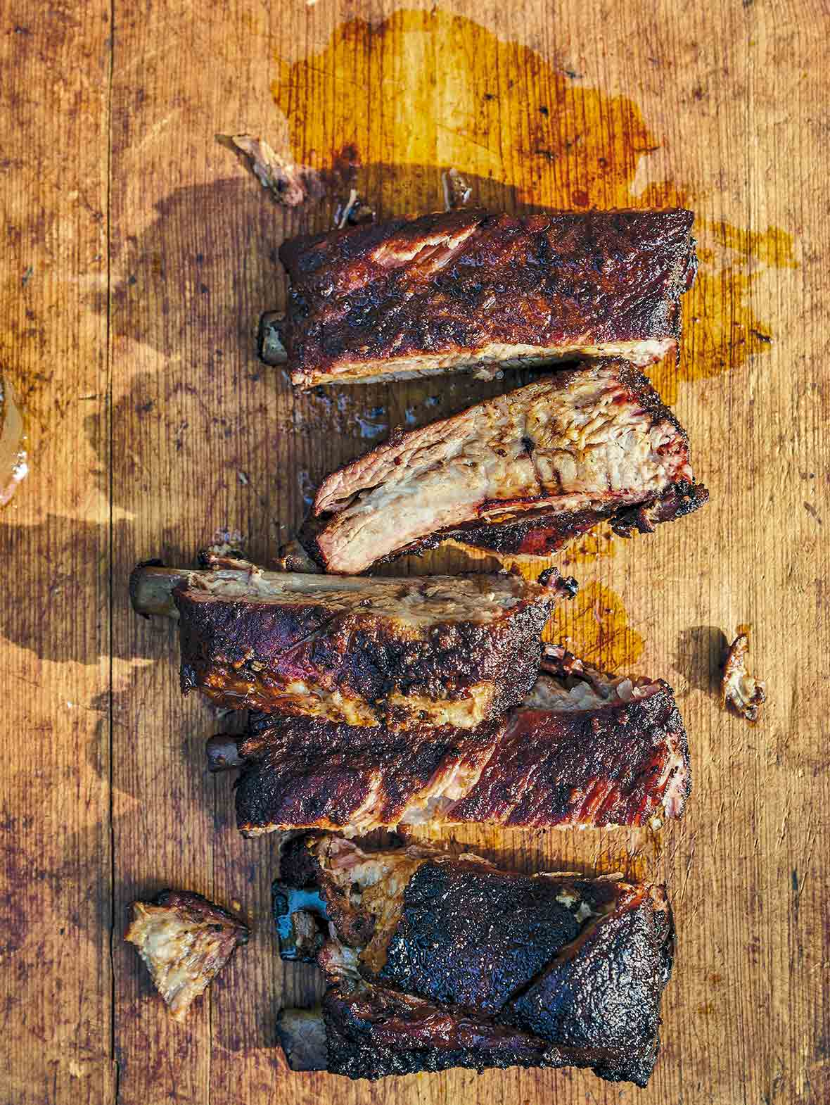 A wooden board with five cut Memphis-style ribs