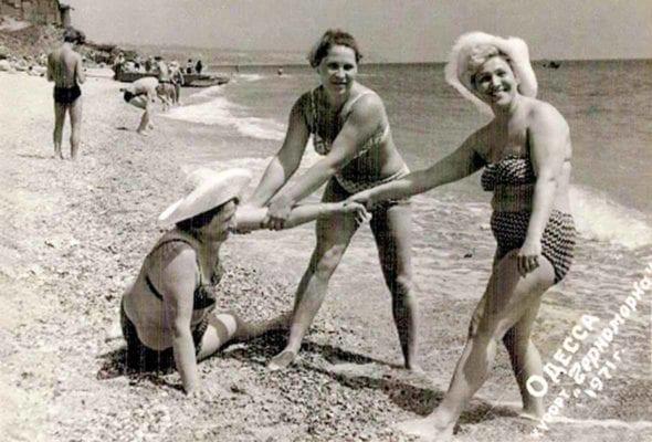Three Russian women on a beach.