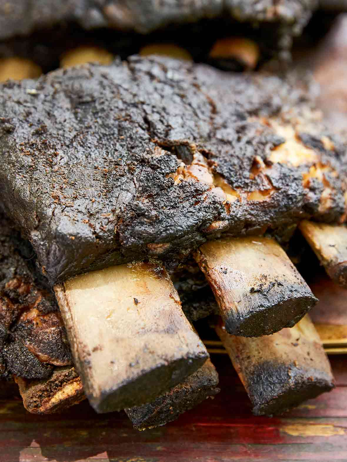 Two slabs of bone-in smoked beef ribs.