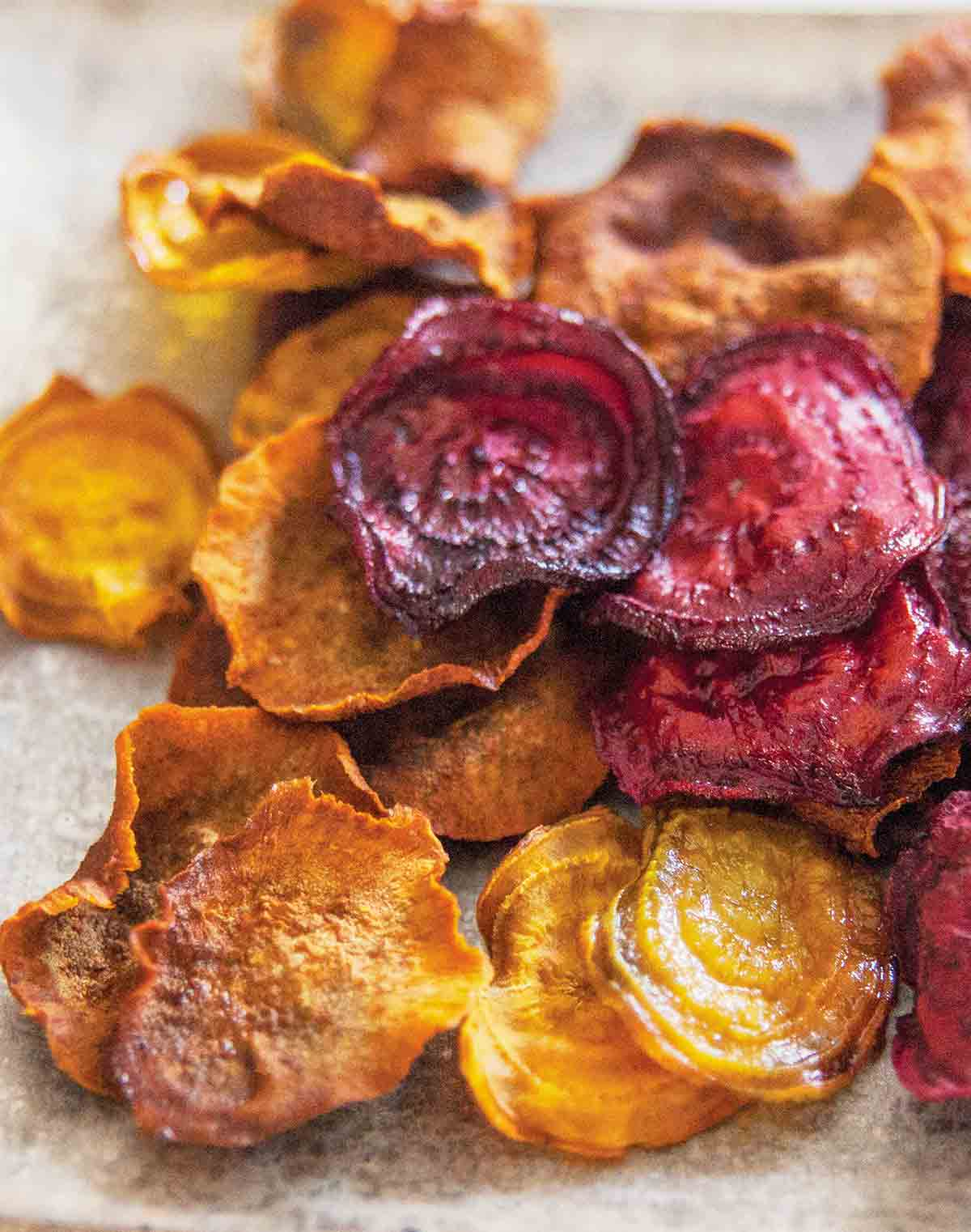 A pile of beet and sweet potato root vegetable chips.