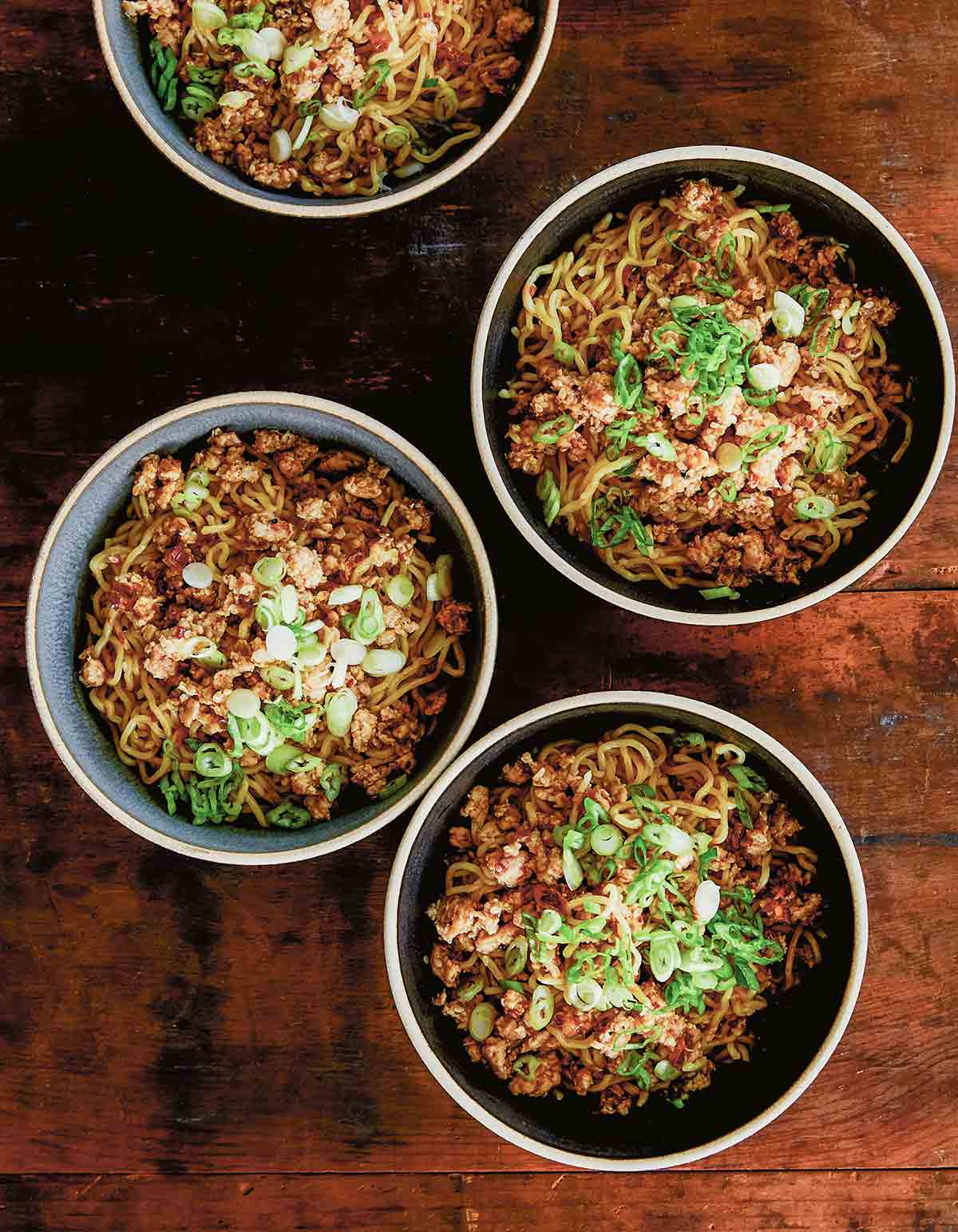 Three bowls of chicken dan dan noodles with Sichuan tare.