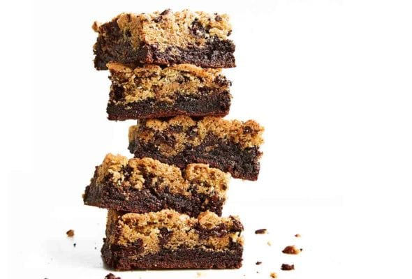 A stack of five chocolate chip cookie brownies.