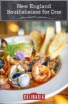 A close up of a white bowl filled with New England bouillabaisse for one.