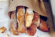 A paper bag filled with loaves of pane Francese.