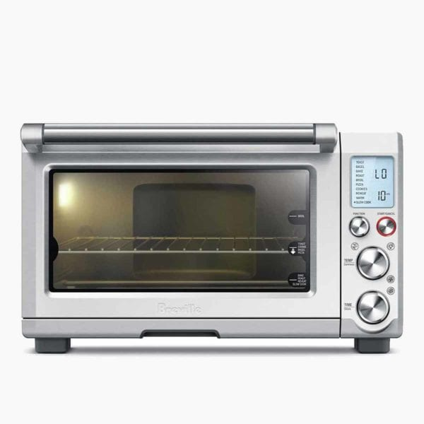 A Breville Smart oven with a light on inside.