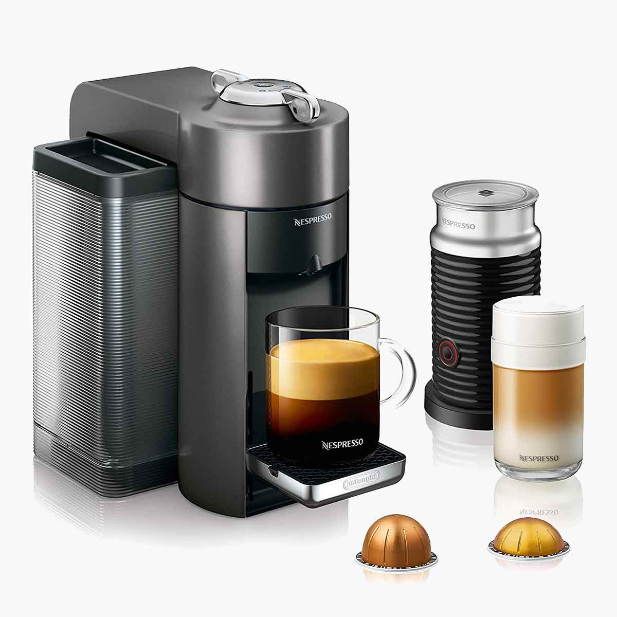 A Nespresso De'Longhi machine with two pods, and a brewed cup of espresso.
