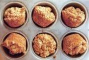 Six Alabama muffin biscuits in a muffin tin.