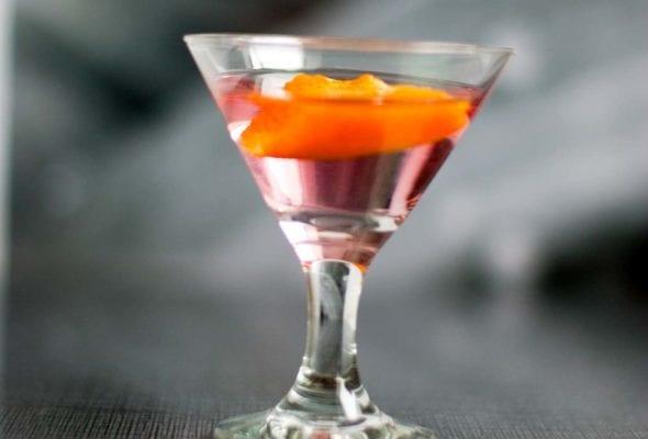Cosmopolitan shot in a small glass.
