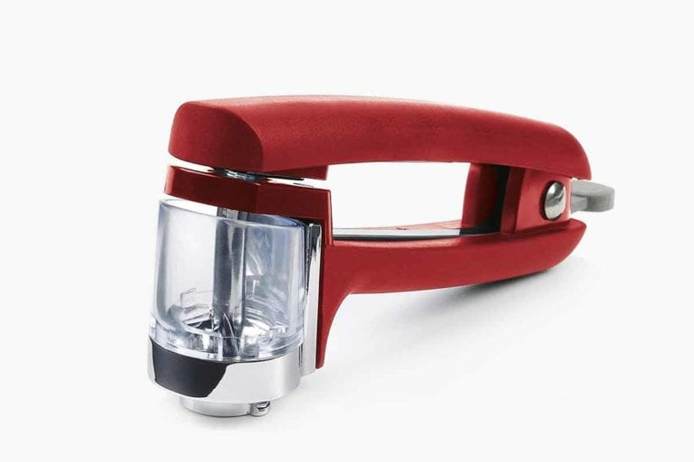 A red OXO cherry and olive pitter.