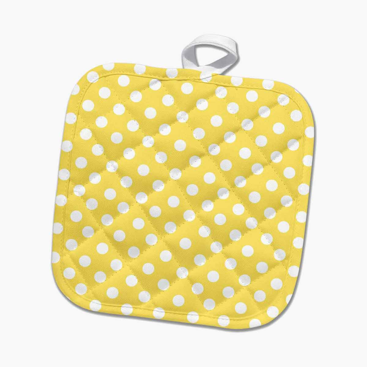 Yellow and white polka dot pot holder.