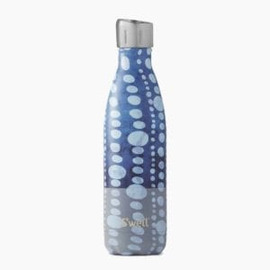 A blue and white polka dot patterned S'well water bottle.