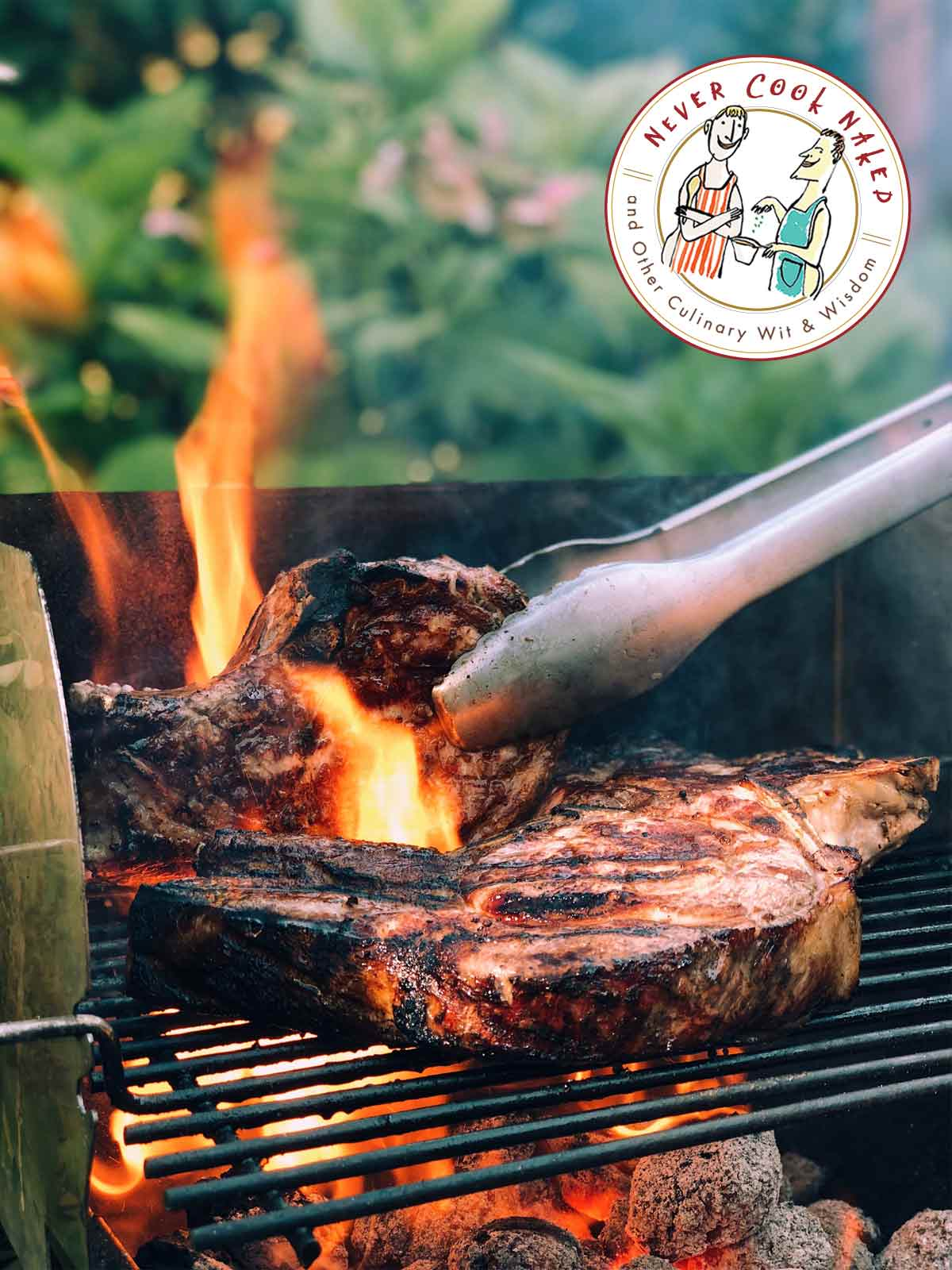 In answer to the question on how to keep food from sticking to the grill, two large chops on a grill, one being turned by metal tongs.