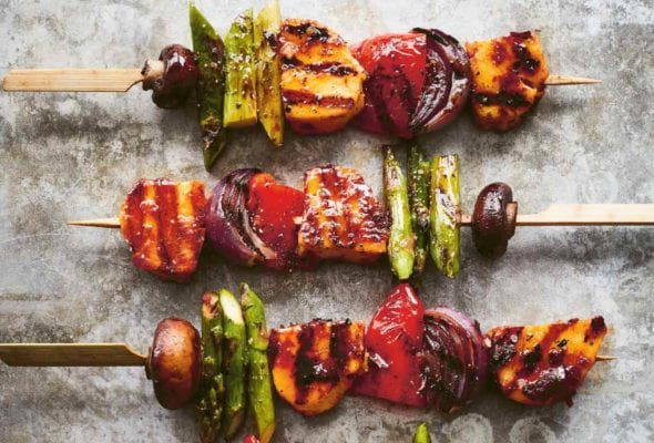 Four grilled vegetable skewers with harissa-marinated halloumi.