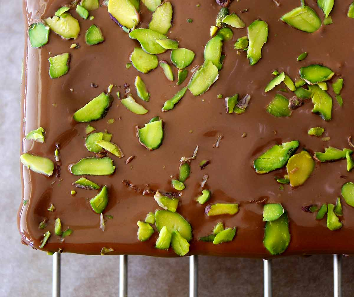 An overhead view of Cenk Sönmezsoy's pistachio-topped brownies.