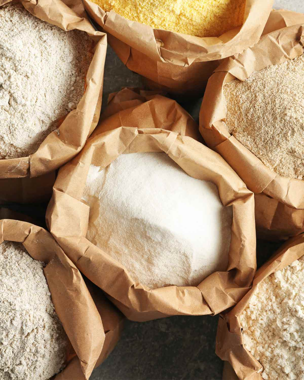 Open bags of different types of flours.
