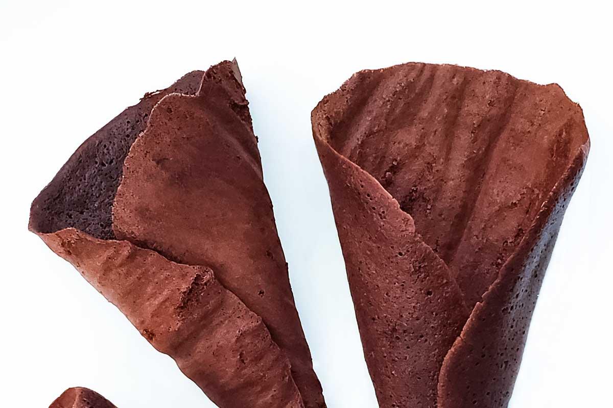 Three homemade chocolate waffle cones.