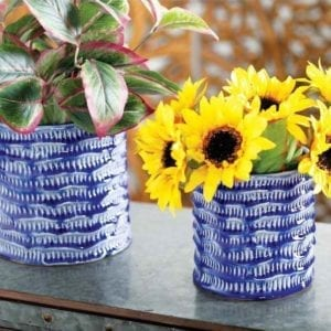 Blue Porcelain Planters with sunflowers in them