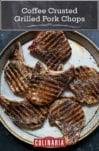 Six coffee-crusted grilled pork chops on a speckled platter.