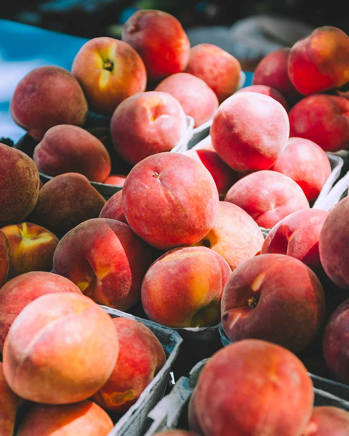Small baskets of perfectly ripe peaches.